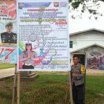 Bripka Hendra Irawan Pasang Banner Ops Patuh Kapuas 2019