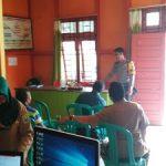 Binluh ke Kantor Desa Bhabinkamtibmas  Himbau Tentang Kesadaran Melaksanakan Siskamling