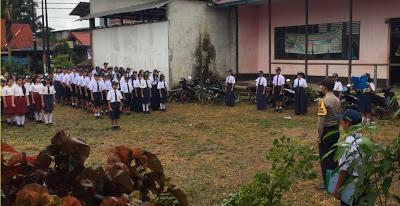 Bhabinkamtibmas Jadi Irup di SMP PGRI Tayan Hulu