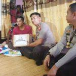 Kepedulian Kapolsek Meliau Berikan Tali Asih kepada Warga yang Menderita Penyakit Tumor