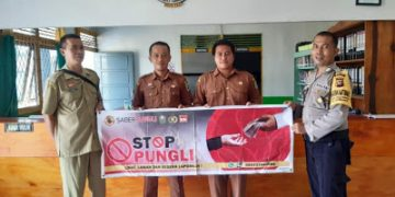 Bhabinkamtibmas Sosialisasikan Stop Pungli ke Kantor Desa