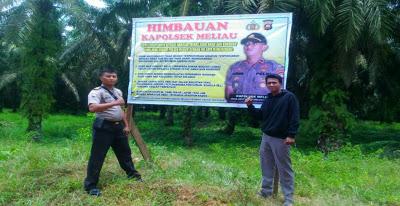 Brigpol Hemmy Khoirul Anam Laksanakan Pemasangan Banner Himbauan Kamtibmas