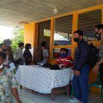 Bhabinkamtibmas dan Babinsa Amankan Pembagian Bantuan Sosial Tunai di Kecamatan Tayan Hilir