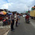 Polsek Sekayam Tingkatkan Pelayanan Lewat Pengamanan Pasar Juadah di Sanggau